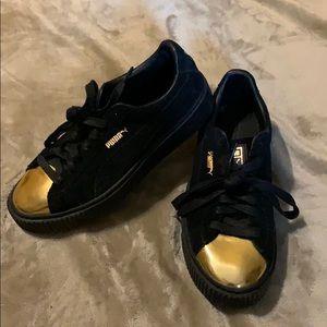 Gold Puma shoes